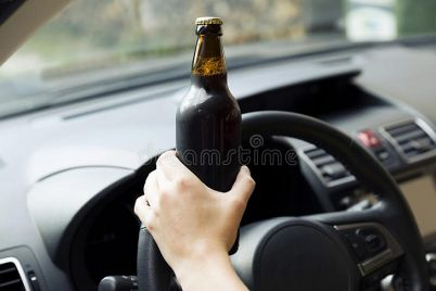transportation-vehicle-concept-woman-drinking-alcohol-whil-driving-car-121418178.jpg