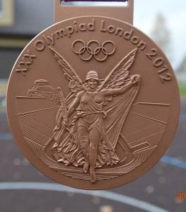 Sportininkas atsivežė ir olimpinį medalį.